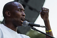 """Aboubakar Soumahoro.<br /> <br /> Rome, 05/07/2020. Today, thousands of people gathered in Piazza San Giovanni to attend the """"Stati Popolari"""". The rally, organised by Aboubakar Soumahoro (1.) - Trade Union Coordinator of the Unione Sindacale di Base USB, was meant to be a popular answer by the """"Invisibles"""" to the """"Stati Generali dell'Economia"""" (States General of the Economy, 2.) of the Italian Prime Minister Giuseppe Conte, a 10-day-long meeting held in June at Villa Doria Pamphili (Villa Doria Pamphilj, 2.) where Italian and EU leaders / members of Governments, bankers, investors, advisors, met to discuss the economic recovery from the Covid-19 / Coronavirus crisis. From the organisers Facebook event page: «The Popular States will be our agora, where different realities will bring their pains and their proposals. A human square to make all the invisible visible and to give voice to all the unheard, our only symbol. The Popular States will be the communion of our needs and our struggles […]» (3.). At the end of the demo Soumahoro, who mainly deals with protection of """"Braccianti"""" (agricultural workers) rights, fights against """"caporalato"""" (illegal hiring) and the exploitation along the agricultural supply chain, gave a speech (4.) addressing the requests to the Government: - National plan for the work emergency; - Public housing program; - integral reform of the food supply chain; - radical transformation of migration policies (including, the """"right to return"""" for Italian migrants); - abolish the """"Security decrees"""" and cancel Bossi-Fini law; - reform the reception; - ecological transition strategy; - proactive interventions against discrimination and for equality.<br /> <br /> Footnotes & Links:<br /> 1. (Wikipedia.org) http://bit.do/fF4rH<br /> 2. 16.06.20 Aboubakar Soumahoro: Hunger/Thirst Strike And Meeting With Italian Prime Minister Conte http://bit.do/fGrbH<br /> 3. http://bit.do/fGrbD & https://www.facebook.com/StatiPopolari/<br /> 4. Aboubakar Soumahoro Speech"""