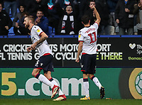 Bolton Wanderers' Will Buckley salutes the crowd after scoring their first goal<br /> <br /> Photographer Andrew Kearns/CameraSport<br /> <br /> The EFL Sky Bet Championship - Bolton Wanderers v Wigan Athletic - Saturday 1st December 2018 - University of Bolton Stadium - Bolton<br /> <br /> World Copyright © 2018 CameraSport. All rights reserved. 43 Linden Ave. Countesthorpe. Leicester. England. LE8 5PG - Tel: +44 (0) 116 277 4147 - admin@camerasport.com - www.camerasport.com
