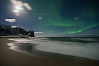 Full moon and northern lights over Unstad beach, Vestvågøy, Lofoten Islands, Norway
