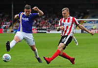 Lincoln City's Harry Anderson vies for possession with Exeter City's Pierce Sweeney<br /> <br /> Photographer Andrew Vaughan/CameraSport<br /> <br /> The EFL Sky Bet League Two Play Off First Leg - Lincoln City v Exeter City - Saturday 12th May 2018 - Sincil Bank - Lincoln<br /> <br /> World Copyright &copy; 2018 CameraSport. All rights reserved. 43 Linden Ave. Countesthorpe. Leicester. England. LE8 5PG - Tel: +44 (0) 116 277 4147 - admin@camerasport.com - www.camerasport.com