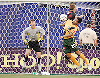 The Galaxy's Carlos Ruiz goes up for a header with the MetroStars' Chris Leitch as MetroStars' goalkeeper Jonny Walker watches. The NY/NJ MetroStars defeated the LA Galaxy 3 to 0 during MLS action at Giant's Stadium, East Rutherford, NJ, on August 8, 2004.