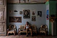HAVANA, CUBA - JUNE 15: Cuban philanthropist and collector, Armando Ricart Balista, a retired Lieutenant, sits in his home filled with Cuban memorabilia in Old Havana, Habana Vieja, on June 15, 2015 in Havana, Cuba. <br /> Daniel Berehulak for Panasonic/Lumix