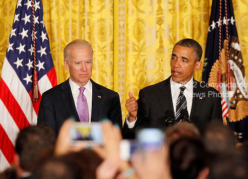 United States President Barack Obama makes remarks next to U.S. Vice President Joe Biden at the LGBT Pride Month celebration in the East Room at the White House on June 13, 2013.  UPI/Molly Riley<br /> Credit: Molly Riley / Pool via CNP