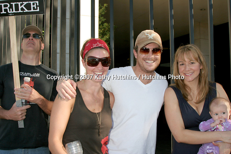 Patrick Warburton, Bianca Kajlich, Oliver Hudson, and Megyn Price & Daughter.Screen Actor's Guild Support the Writer's Guild of America Strike.Outside NBC/Universal Studios Lot.Lankershim Blvd.Los Angeles, CA.November 13, 2007.©2007 Kathy Hutchins / Hutchins Photo...               .