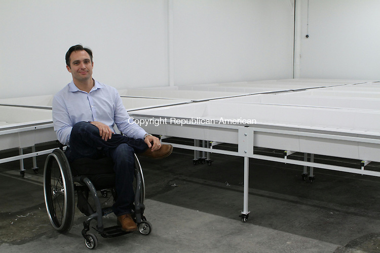 WATERTOWN, CT June 13 2014-061314LW01 - Ethan Ruby, principal at Theraplant, sits in the harvesting room of his medical marijuana growing facility in Watertown.<br /> Laraine Weschler Republican-American