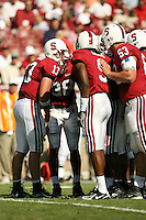 14 October 2006: T.C. Ostrander in the huddle with Richard Sherman, Austin Yancy and Chris Marinelli during Stanford's 20-7 loss to Arizona during Homecoming at Stanford Stadium in Stanford, CA.