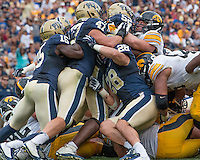 the Pitt defense gang tackles an Iowa ball carrier. Shown are Reggie Mitchell (15),  Matt Gallambos (47), Anthony Gonzalez (28) and Shakir Soto (52). Iowa Hawkeyes defeated the Pitt Panthers 24-20 at Heinz Field, Pittsburgh Pennsylvania on September 20, 2014.