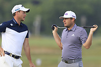 Danny Willett and Tyrrell Hatton (ENG) chat on the 8th green during Friday's Round 2 of the 118th U.S. Open Championship 2018, held at Shinnecock Hills Club, Southampton, New Jersey, USA. 15th June 2018.<br /> Picture: Eoin Clarke | Golffile<br /> <br /> <br /> All photos usage must carry mandatory copyright credit (&copy; Golffile | Eoin Clarke)