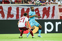 Lucas Moura of Tottenham Hotspur in action with Kostas Tsimikas of Olympiacos Fc, during the UEFA Champions League match between Olympiacos Fc and Tottenham Hotspur, in Karaiskaki Stadium in Piraeus, Greece. Wednesday 18 September 2019
