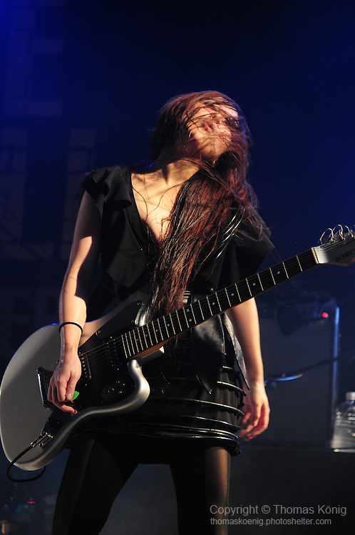 Kaohsiung, Taiwan -- Guitarsit MAY of the Japanese metal band SOUNDWITCH dancing on stage during the 'Kiss Me Kill Me 2011 Tour' at The Wall Live House (Pier 2) in Kaohsiung, Taiwan.