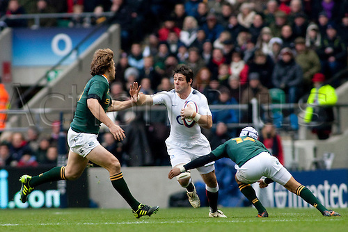 TWICKENHAM LONDON, 27-11-2010. England's Ben Foden, is tackled by South Africa's Jannie du Plessis, and South Africa's Gio Aplon,   during the Investec International match between England and South Africa at Twickenham Stadium Middlesex England.