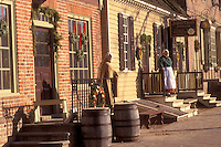 Colonial Williamsburg, Virginia, VA, Williamsburg, Interpreters wearing colonial costumes stand outside the village stores in Colonial Williamsburg.