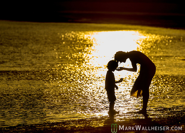 A woman interacts with her son on Mother's Day eve.