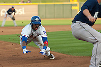 Round Rock Express outfielder Julio Borbon #20 slides into third during first inning of the Pacific Coast League baseball game against the New Orleans Zephyrs on April 30, 2012 at The Dell Diamond in Round Rock, Texas. The Zephyrs defeated the Express 5-3. (Andrew Woolley / Four Seam Images)