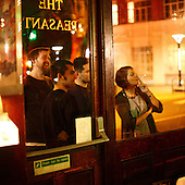 "London, Great Britain, July 2010:.Guests smoking cigarettes outside ""The Pheasant"" pub in City of London..(Photo by Piotr Malecki / Napo Images)..Londyn, Wielka Brytania, Lipiec 2010:.Goscie pala papierosy przed pubem ""The Pheasant"" , City of London.. Fot: Piotr Malecki / Napo Images"