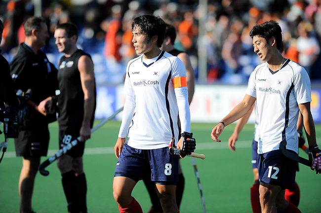 The Hague, Netherlands, June 01: Seungil Lee #8 and Manjae Jung #12 of Korea leave the field afterthe field hockey group match (Men - Group B) between the Black Sticks of New Zealand and Korea on June 1, 2014 during the World Cup 2014 at GreenFields Stadium in The Hague, Netherlands. Final score 2:1 (1:0) (Photo by Dirk Markgraf / www.265-images.com) *** Local caption ***