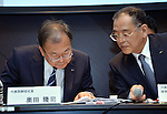 February 1, 2013, Tokyo, Japan - President Takashi Okuda, left, of Japan's Sharp Corp. checks details with its executive Tetsuo Onishi as they announce the company's third-quarter earnings during a news conference at a Tokyo hotel Friday evening, February 1, 2013. In the three months to Dec. 31, Japanese electronics giant posted operating profit of $28.5 million in its third quarter earnings but the company recorded a net loss of $398 million for the period. (Photo by Natsuki Sakai/AFLO) AYF -mis-
