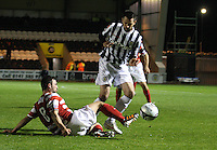 Gary Fisher tackles Steven Thompson in the St Mirren v Hamilton Academical Scottish Communities League Cup match played at St Mirren Park, Paisley on 25.9.12.