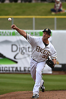 Jarrett Grube (39) of the Salt Lake Bees warms up prior to the game against the Sacramento River Cats at Smith's Ballpark on April 3, 2014 in Salt Lake City, Utah.  (Stephen Smith/Four Seam Images)