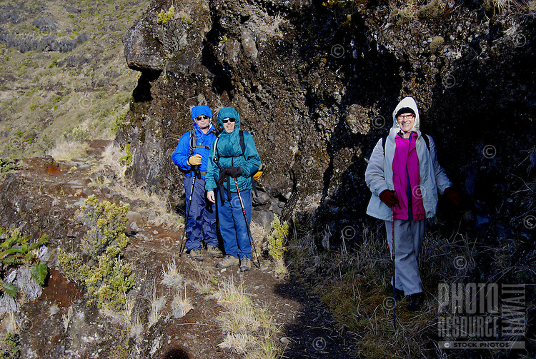 Babyboomers hiking the Halemauu trail, Haleakala Crater, Haleakala National Park