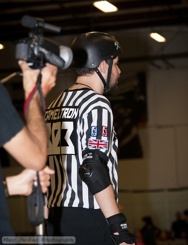 Man O'Pause films head referee Cameltron.