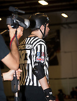 Man O'Pause films head referee Cameltron.
