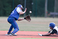 13 July 2010: Luc Piquet of Team France eyes the ball as Jordan Pennington dives into second base during day 1 of the Open de Rouen, an international tournament with Team France, Team Saint Martin, Team All Star Elite, at Stade Pierre Rolland, in Rouen, France.