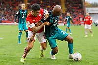 (L-R) Jacob Brown of Barnsley challenges Andre Ayew of Swansea City during the Sky Bet Championship match between Barnsley and Swansea City at Oakwell Stadium, Barnsley, England, UK. Saturday 19 October 2019