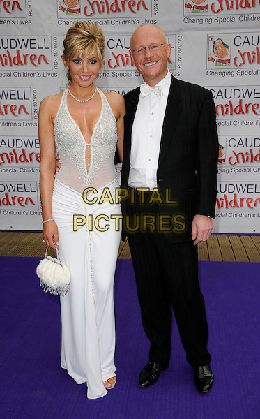 GUEST & JOHN CAUDWELL.The Caudwell Children's Butterfly Ball, Battersea Evolution, Battersea Park, London, England..May 14th, 2009.full length white sheer plunging neckline dress jewel encrusted silver blask suit shirt.CAP/CAN.©Can Nguyen/Capital Pictures.