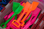 Display of brightly coloured plastic toy spades at the seaside town of Cromer, north Norfolk coast, England