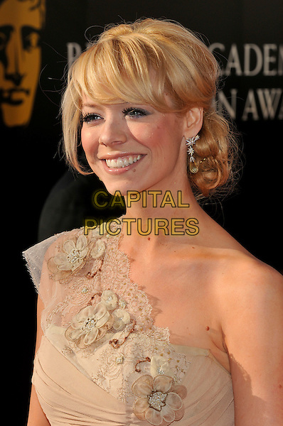 LIZ McCLARNON .Arrivals at the British Academy Television Awards 2009, Royal Festival Hall, London, England. 26th April 2009..TV Baftas bafta's portrait headshot  profile gold beige one shoulder fringe hair up McLarnon flowers .CAP/PL.©Phil Loftus/Capital Pictures