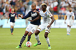 07 December 2014: New England's Teal Bunbury (10) and Los Angeles's Gyasi Zardes (11). The Los Angeles Galaxy played the New England Revolution in Carson, California in MLS Cup 2014. Los Angeles won 2-1 in overtime.