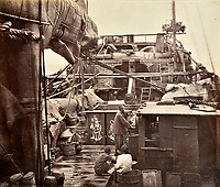 BNPS.co.uk (01202 558833)<br /> Pic: DominicWinterAuction/BNPS<br /> <br /> Chinese Junk.<br /> <br /> Revealed - A fascinating photo album from the very early days of British Hong Kong...long before the skyscrapers covered it over.<br /> <br /> The 150 year old photos of Hong Kong taken by one of the first British photographers to venture to the Far East have emerged for sale for £15,000.<br /> <br /> John Thomson, who was also a geographer, left Edinburgh for Singapore in 1862 and spent the following decade travelling the region.<br /> <br /> He explored a decidely low-rise Hong Kong from 1868 to 1870, taking numerous pictures of the rapidly expanding settlement and its industrious inhabitants.<br /> <br /> They capture the area, which is currently engulfed in unrest and protest, at a far more tranquil time.<br /> <br /> The photos are being sold with auction house Dominic Winter, of Cirencester, Gloucs.