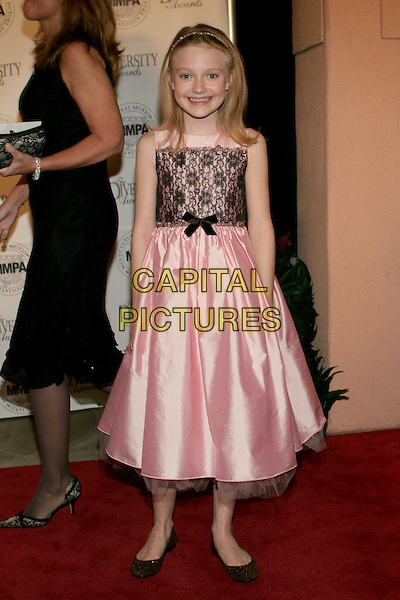 DAKOTA FANNING.2005 Diversity Awards presented by the Multicultural Motion Picture Association held at the Beverly Hills Hotel, Beverly Hills, California.  .November 13th, 2005.Photo: Zach Lipp/AdMedia/Capital Pictures.Ref: ZL/ADM.full length pink black lace dress .www.capitalpictures.com.sales@capitalpictures.com.© Capital Pictures.