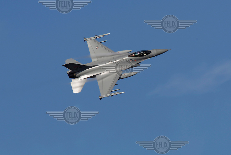 "?Lockheed Martin F-16 fighter plane display over over Oslo as The Royal Norwegian Air Force celebrate ""100 years of airpower""."