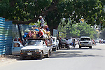 Many People Riding On Top Of Vehicle