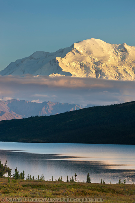 Evening light falls on the North face summit of Denali, North America's tallest mountain. Wonder Lake in the foreground, Denali National Park, Interior, Alaska.