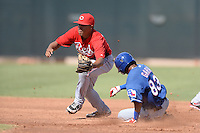 Cincinnati Reds second baseman Avain Rachal (78) takes the throw as Chris Garia (83) slides in during an Instructional League game against the Texas Rangers on October 7, 2013 at Goodyear Training Complex in Goodyear, Arizona.  (Mike Janes/Four Seam Images)