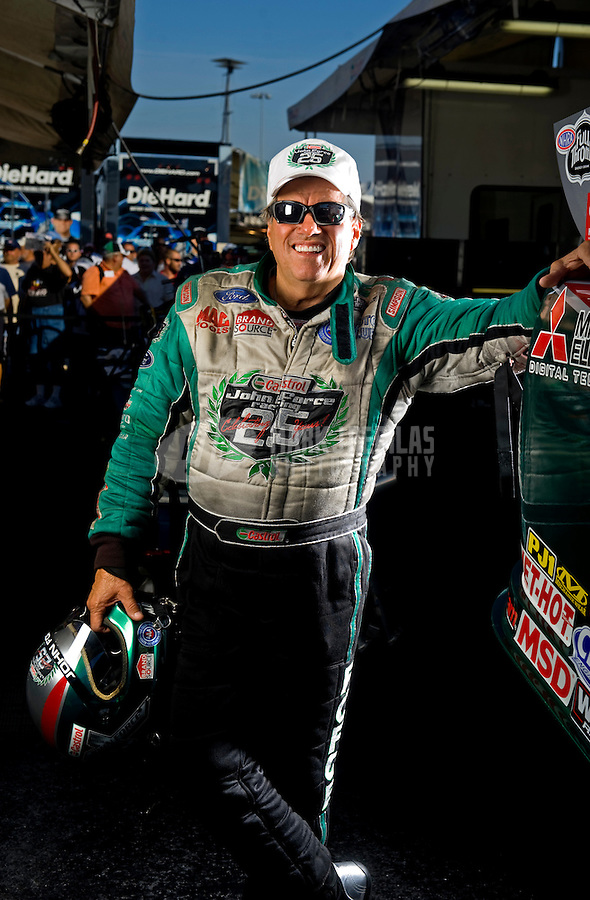 Sept. 19, 2010; Concord, NC, USA; NHRA funny car driver John Force poses for a portrait during the O'Reilly Auto Parts NHRA Nationals at zMax Dragway. Mandatory Credit: Mark J. Rebilas for ESPN the Magazine
