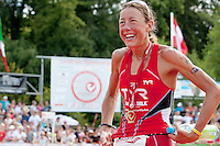 Chrissie Wellington breaks a world record and wins first place for women at the Challenge Roth Ironman Triathlon, Roth, Germany, 10 July 2011