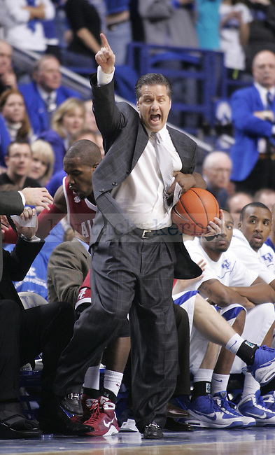 UK head coach John Calipari yells about a referee's call as Alabama's junior forward Chris Hines falls out of bounds towards him during the second quarter of the UK men's basketball game against Alabama at Rupp Arena on Tuesday, Feb. 9, 2010. Photo by Adam Wolffbrandt | Staff