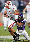 November 21, 2009: Northwestern Wildcats defensive back Jordan Mabin (26) tackles Wisconsin Badgers wide receiver Nick Toon (1) during an NCAA football game at  Ryan Field on November 21, 2009 in Evanston, Illinois. The Wildcats won 33-31. (Photo by David Stluka)