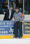 February 6, 2010:   Air Force head coach, Frank Serratore, talks with an official during a heated match-up between #2 Denver University and Air Force at Cadet Ice Arena, U.S. Air Force Academy, Colorado Springs, Colorado.  #2 Denver defeats Air Force 2-1 in OT.