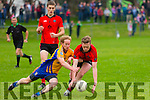Padraig O'Sullivan (Beaufort) in action with Joe McGillicuddy (Glenbeigh-Glencar) in the Castleisland Co-Op Mart Livestock Mart Ltd,Castleisland Mart, Junior Football Championship Semi-Final at JP O'Sullivan Park,Killorglin on Saturday.