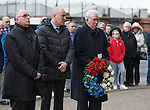 John Greig about to lay a wreath alongside manager Mark Warburton and director John Gilligan at the Ibrox disaster memorial statue