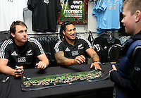 All Black Ben Smith, left, and Ma'a Nonu meet  a young fan courtesy of Adidas prior to the Rugby Championship, Bledisloe Cup test match between New Zealand and Australia, Champions of the World store, Dunedin, New Zealand, Friday, October 18, 2013. Photo: Dianne Manson / photosport.co.nz