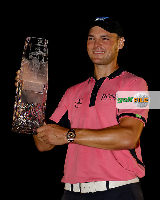 11 MAY 14 Martin Kaymer holds the crystal at the conclusion of Sunday's rainy Final Round at The Players Championship at The TPC at Sawgrass in Ponte Vedra Beach, Florida. (photo credit : kenneth e. dennis/kendennisphoto.com)