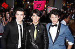 "HOLLYWOOD, CA. - February 24: Musicians Kevin Jonas and Joe Jonas of The Jonas Brothers arrive at the Los Angeles premiere of ""Jonas Brothers: The 3D Concert Experience"" at the El Capitan Theatre on February 24, 2009 in Los Angeles, California."