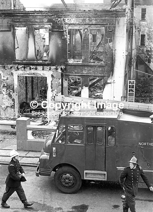 Firemen were still at the Royal Hotel, Whitehead, the morning after its owner, Larry McMahon, Newtownabbey, Co Antrim, married, 4 children, Roman Catholic, was murdered at his Newtownabbey home by the UVF, Ulster Volunteer Force, a loyalist paramilitary organization, on 15th March 1973. An explosive device detonated killing him instantly when he went to investigate a noise at his front door at 21.45. His wife and some of his children were also injured. Mr McMahon's success was a rags to riches story. He started off as a barman and ended up owning the Royal Hotel in Whitehead and a chain of betting shops as well as three pubs. 197303150134g<br /> <br /> Copyright Image from Victor Patterson, 54 Dorchester Park, Belfast, United Kingdom, UK.  Tel: +44 28 90661296; Mobile: +44 7802 353836; Voicemail: +44 20 88167153;  Email1: victorpatterson@me.com; Email2: victor@victorpatterson.com<br /> <br /> For my Terms and Conditions of Use go to http://www.victorpatterson.com/Terms_%26_Conditions.html
