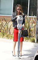 Jessica Alba looked hot in her casual business attire with a red dress, cropped leather jacket. pumps and bag while feeding the parking meter with her credit card. Los Angeles, California on 18.05.2012..Credit: Correa/face to face.. /MediaPunch Inc. ***FOR USA ONLY***